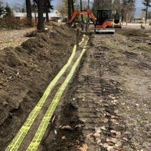 excavator working ditch line